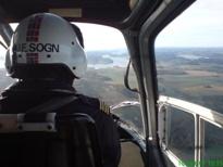 Helikopter transport av hytte materialer Lasteflyging
